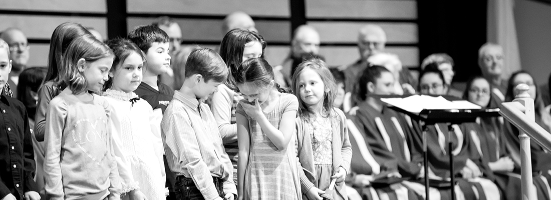 Sunday school students laugh as they sing for Sunday morning service at Fair Haven Baptist Church